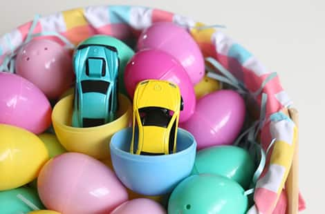 Mini-cars in plastic Easter eggs.