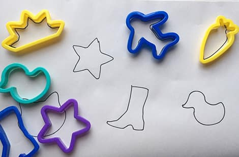 Traced cookie cutters on a sheet of blank paper.