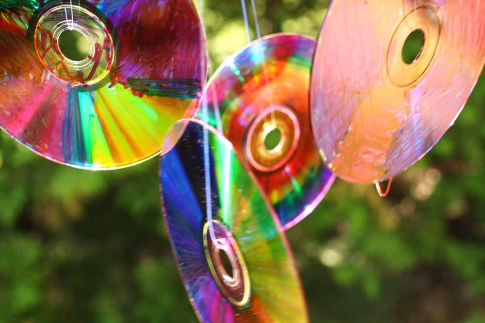 4 coloured CDs handing from fishing line.