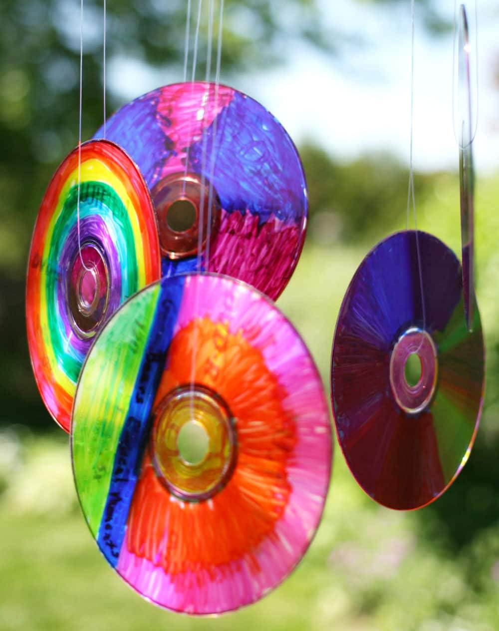 A completed coloured CD suncatcher hangs in the sun.