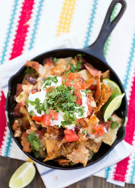 Colourful and mouth-watering loaded chili nachos with the works!