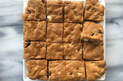 Freshly baked cranberry and white chocolate cookie butter blondies.