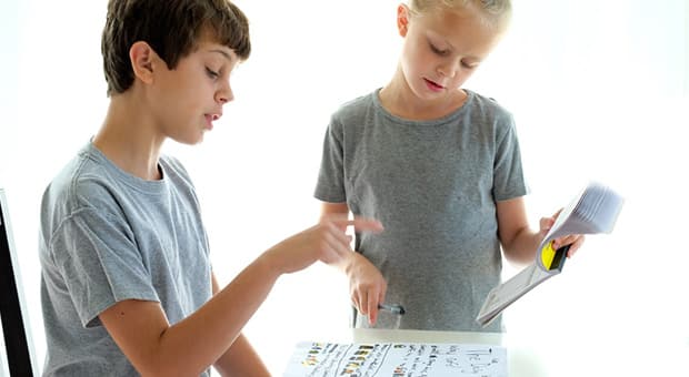 Kids pretending to take orders from a menu