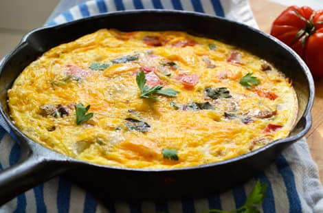 A finished frittata in a skillet, ready to serve