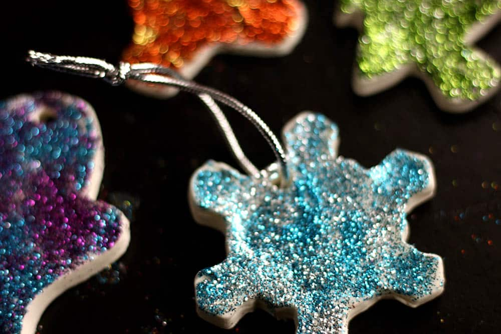 Closeup of a blue sparkly snowflake clay dough ornament