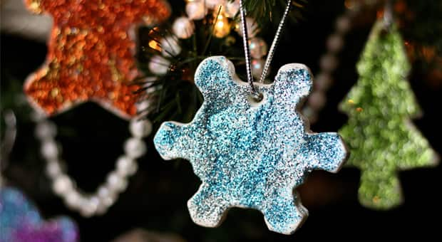 A blue sparkly snowflake clay dough ornament