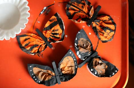 Completed coffee filter monarch butterflies on an orange tray