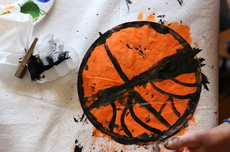 Painting the coffee filters orange and black