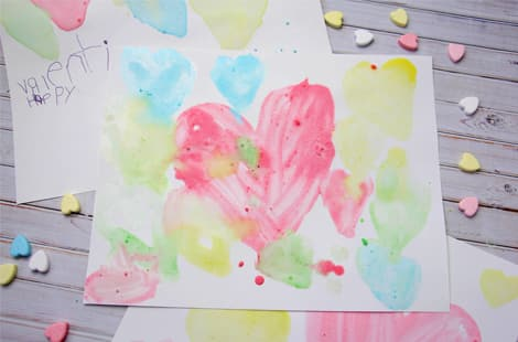 Paintings of hearts made with conversation hearts paint
