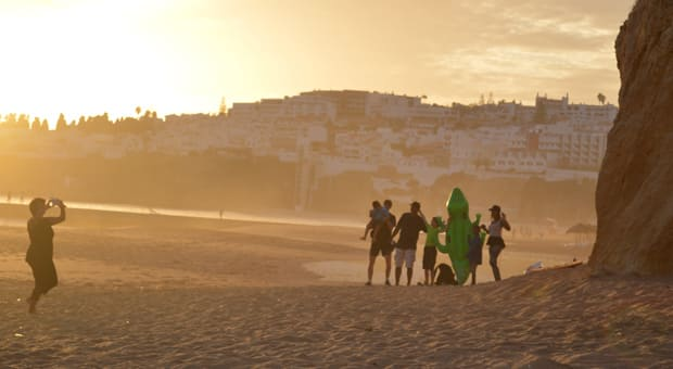 A family on a beach having their photo taken