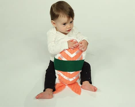 picture of child wearing sushi costume