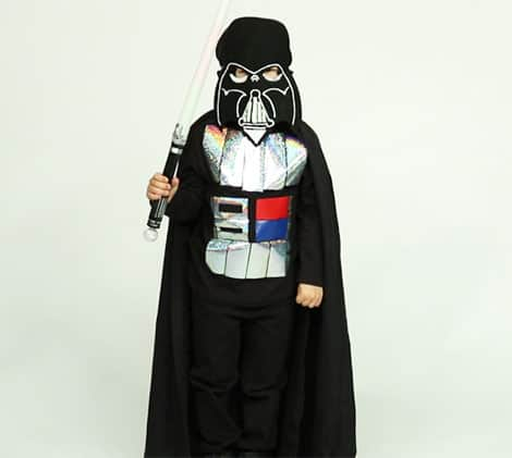 a photo of a child dressed up as darth vader