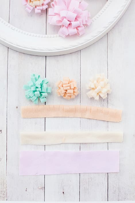 Folded strips of felt with cuts on the folded edge.