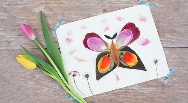 A butterfly made out of flower petals.