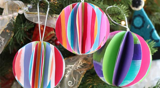 Colourfully striped folded paper ball ornaments on a Christmas tree