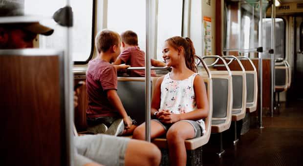 Two kids on a transit bus