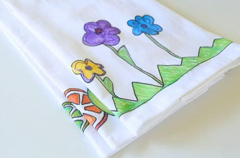 Folded towel with colourful flowers.