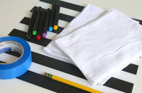 Hand-drawn towels, fabric markers, pencil and painters tape.
