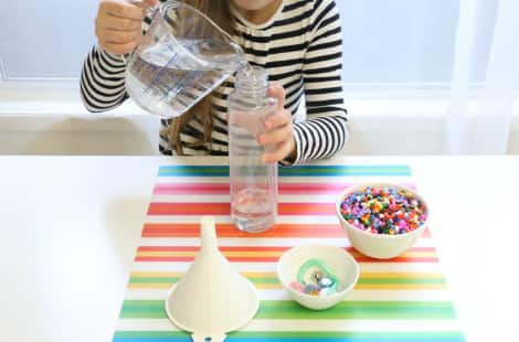 Pouring water into the I Spy bottle
