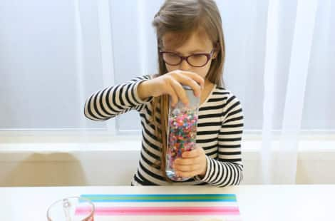 Securing the lid of the I Spy bottle