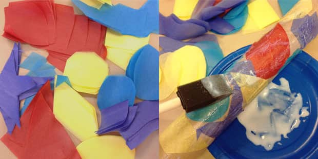 Tissue paper shapes being glued onto a paper towel roll.
