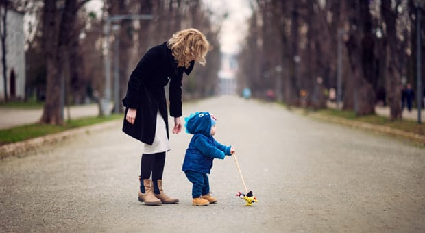 A mother with her son, crossing a street