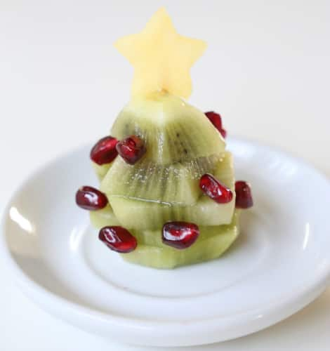 The completed kiwi Christmas tree with pomegranate arils as ornaments