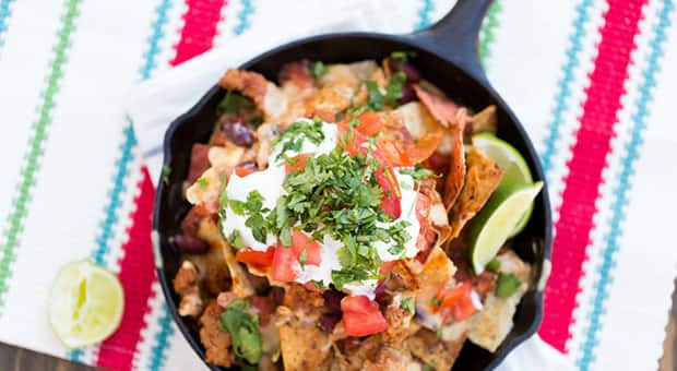 Colourful and mouth-watering loaded chili nachos.