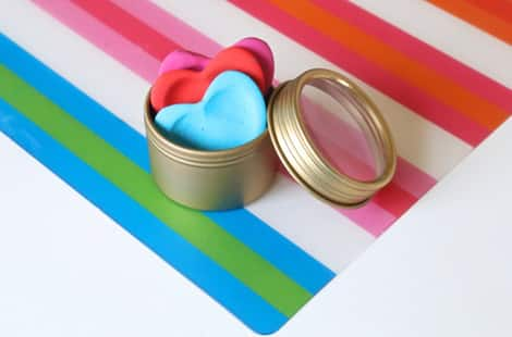 Completed love tokens in a small tin