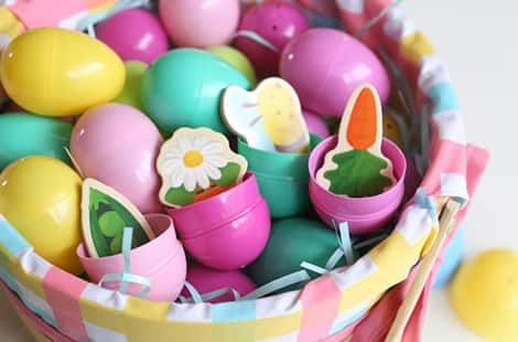 Wooden magnets inside colourful Easter eggs.