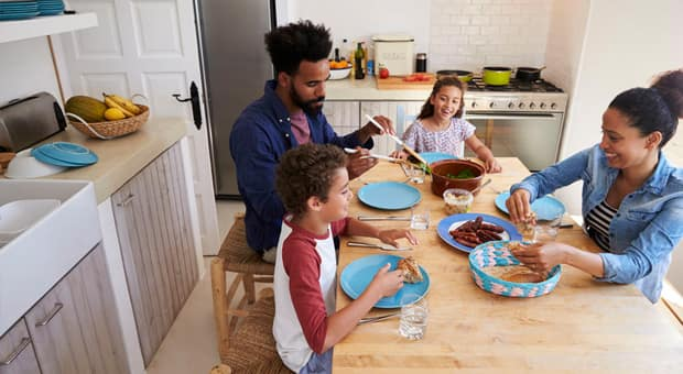 A family sitting down for a meal