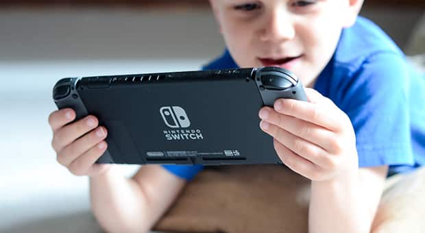 Child plays on Nintendo Switch