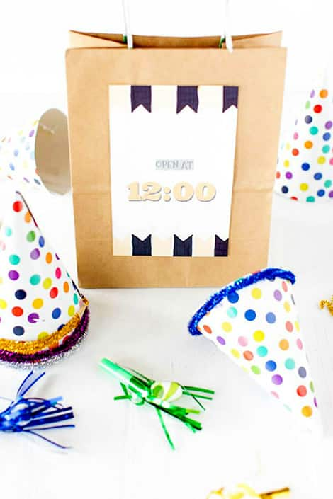 Party hats and noise makers around a 12 a.m. New Year's Eve bag