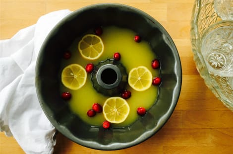 The juice and fruit in a bundt pan ready to be frozen