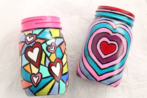 Completed painted jars with colourful hearts