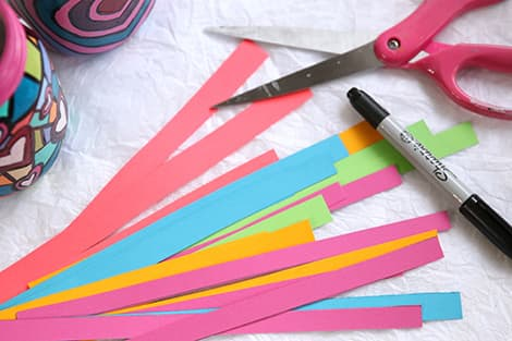 Cutting out colourful paper strips