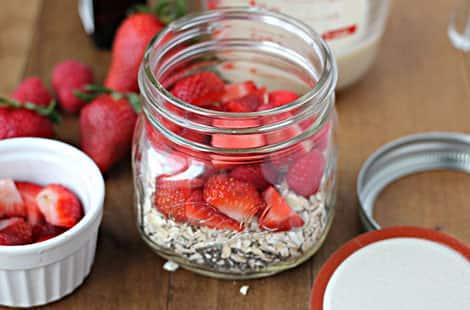 Strawberries, oats in jar before liquid added.