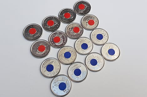 Eight dimes with red dot stickers; eight dimes with blue dot stickers.