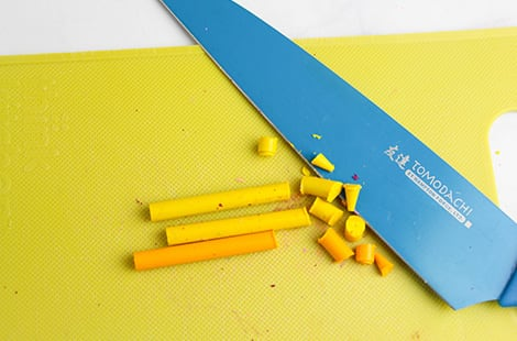 Chopping up the crayons with a kitchen knife.