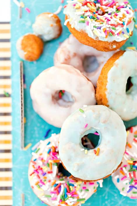 Plate of colourful and sweet-looking doughnuts.
