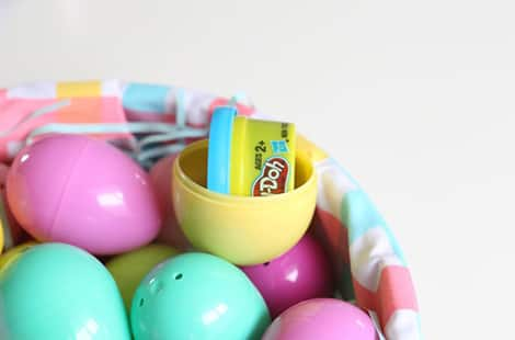 Mini-play doh in plastic Easter eggs.