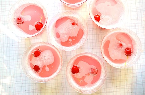 Pink punch with cherries floating.