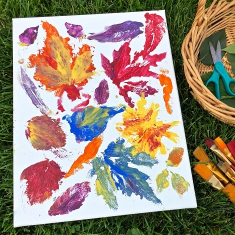 A canvas with many colourful leaf prints