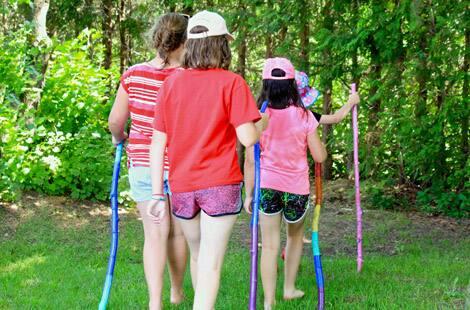 Kids walking with their painted walking sticks