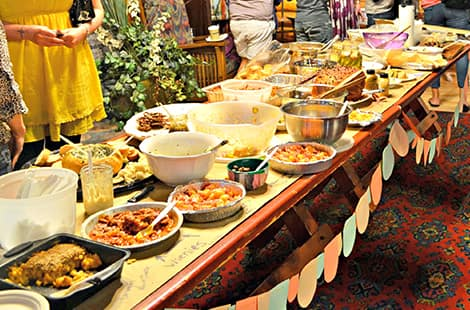 A large and varied table full of casseroles dishes.