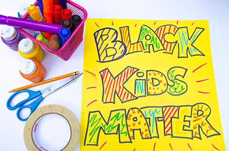 Black Kids Matter sign coloured in