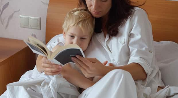 A woman reading a book with her child