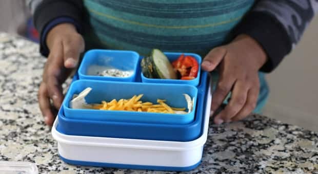 A child opening their lunch box