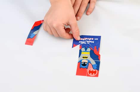 A child putting together a Valentine's card puzzle