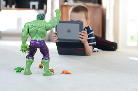 Filming a toy Hulk with an iPad.